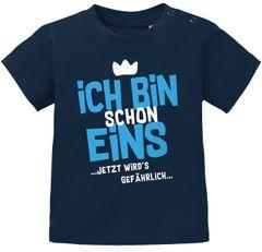Baby T-Shirt 1. Geburtstag Spruch Ich bin schon 1 jetzt wird's gefährlich Geburtstagsshirt Bio-Baumwolle MoonWorks®